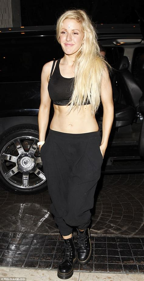 ellie goulding reveals intricate lotus tattoo design etched   ribs daily mail