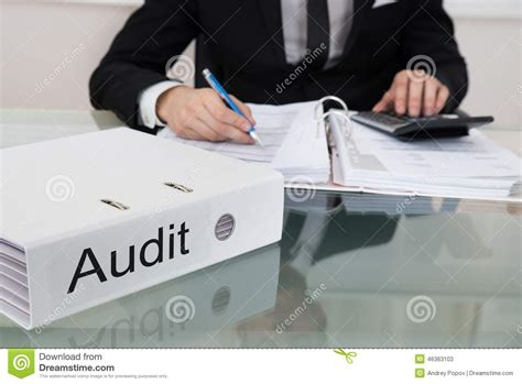 Opm Desk Audit Back Pay by Businessman Calculating Taxes At Desk Stock Photo Image