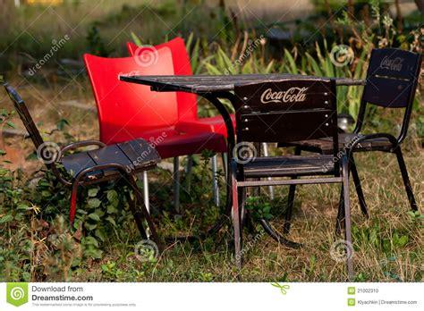 garden furniture with the logo coca cola editorial image
