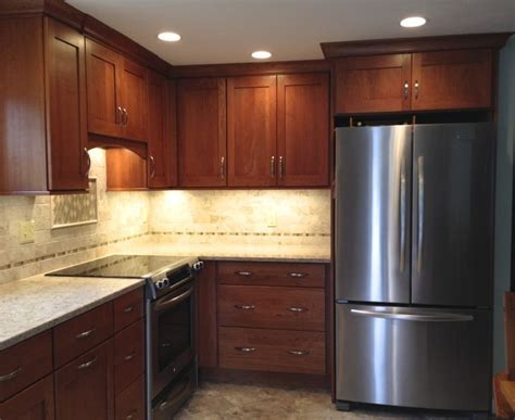 "Omega ""Morris"" Cherry Cinnamon cabinetry with Quasar"