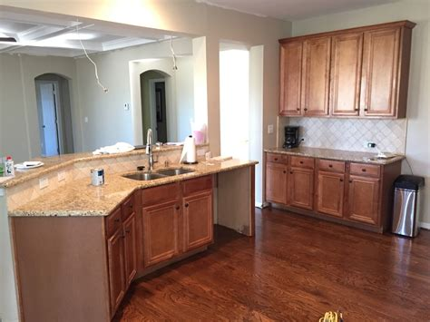 painting wood kitchen cabinets painting kitchen cabinets before after mr painter