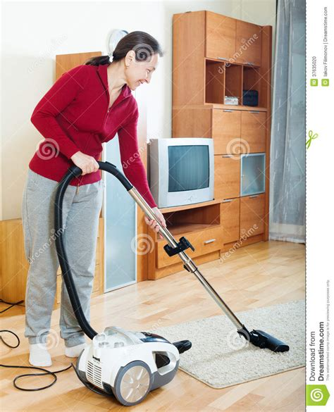 vacuuming floors mature woman cleaning with vacuum cleaner stock photo image of room mature 37635020