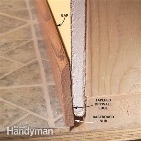 how to install baseboard molding even crooked walls the family handyman