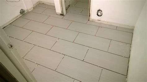 how to lay tile flooring girlsvsblog