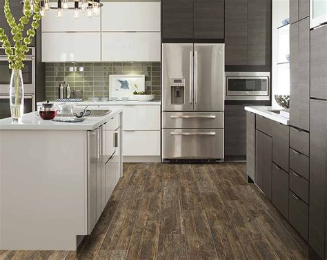 That bright blue handle of the whisk painted on the board adds a pop of color. Kitchen Remodel & Design Trends For 2020 | Flooring America