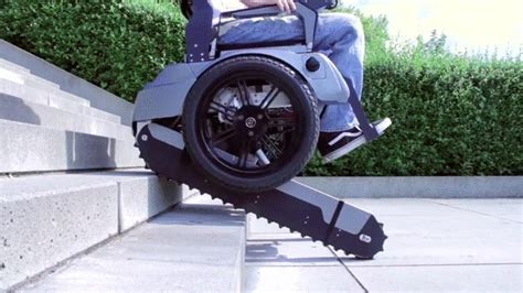 a wheelchair that can go up stairs gifs
