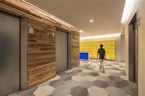 reclaimed wood elevator lobby   pop  bright color