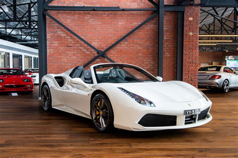 Unlike the ferrari f8 tributo coupe, which costs around $50,000 less and has a fixed roof, the spider's metal roof can pivot open at the touch of a button, transforming the striking italian. Ferrari 488 Spider Price Australia - allie baxter