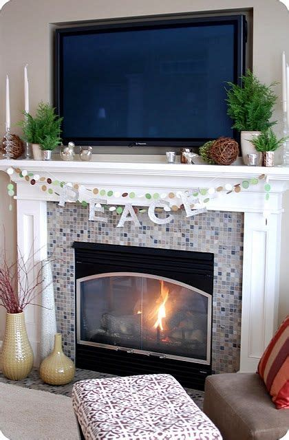 decorating fireplace mantel with tv above mantel with tv decorating ideas like the idea of putting
