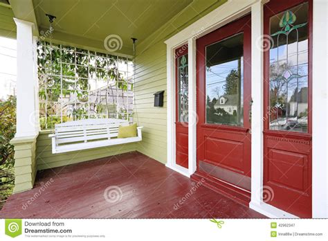 entrance porch  red  green color  hanging swing