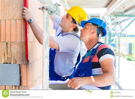 construction workers  site checking quality stock images