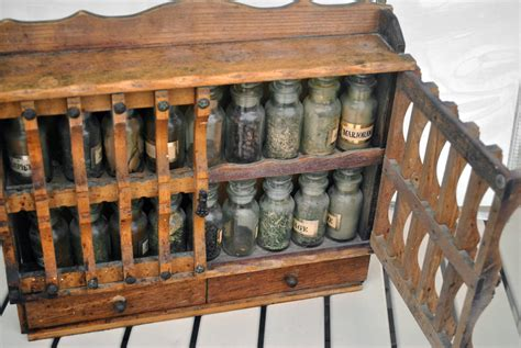 vintage wall mounted spice rack cabinet  glass bottles