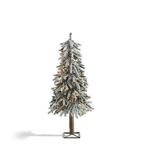 realistic rustic snow lighted pre lit alpine tree indoor