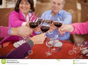 Elderly Friends Saying Cheers With Red Wine Royalty Free ...