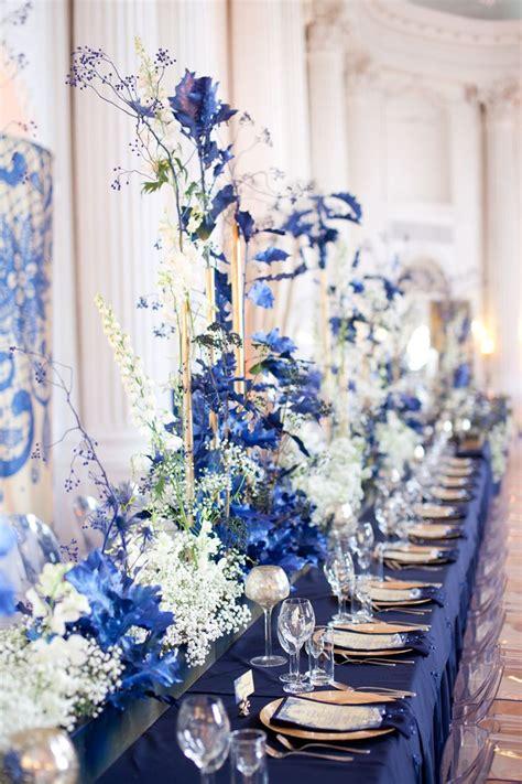 navy blue wedding reception in rydzyna castle poland by