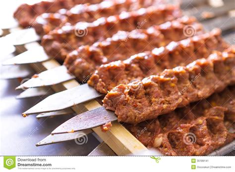 cuisine syrienne seasoned adana kebabs on skewers waiting to be cooked