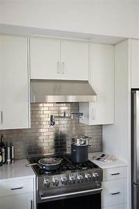 Hidden flatscreen tv over kitchen hood transitional for Kitchen colors with white cabinets with brushed aluminum wall art