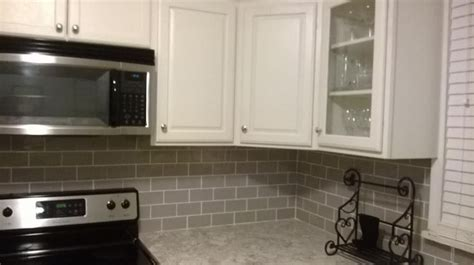 gorgeous kitchen remodel using smoke glass subway tile