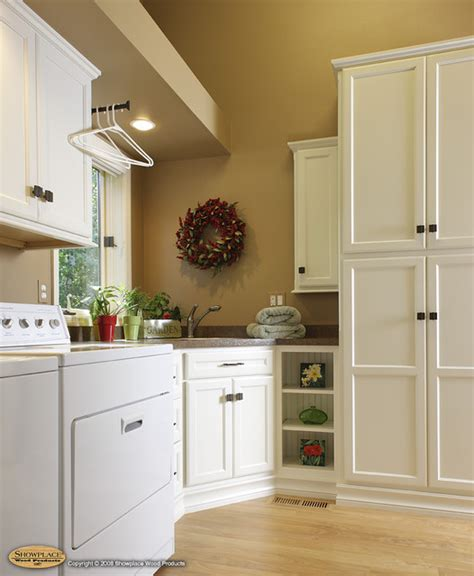 white pull kitchen faucet showplace cabinets laundry room traditional laundry room other by showplace wood products