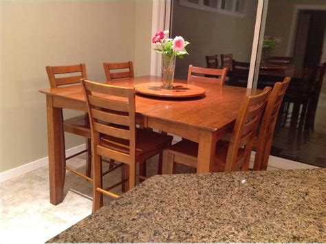 solid wood pub style table with 6 chairs leaf and lazy