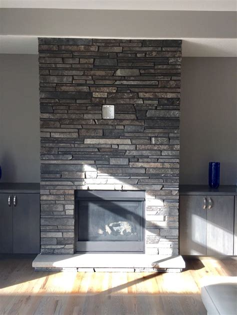 gray  brown dry stacked stone fireplace grey stone