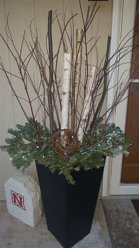 wintery decorations   christmas front porch birch