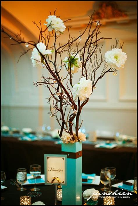 wedding centerpieces with branches and flowerswedwebtalks