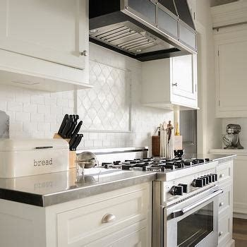 white cabinets  black arabesque tiles