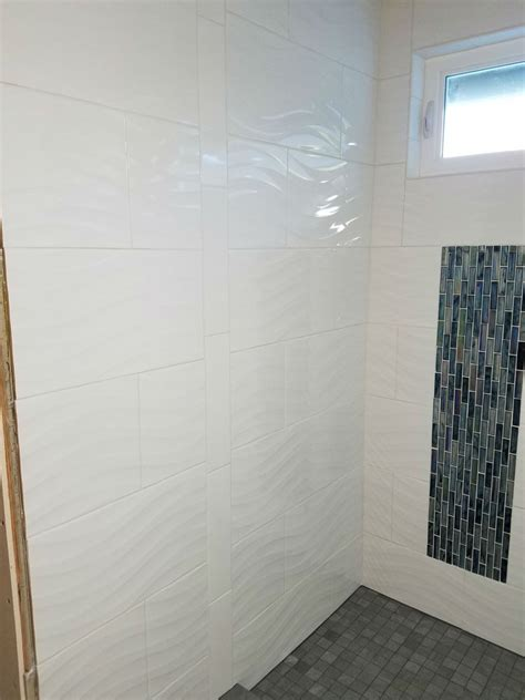 white wavy tile shower wall bought the wavy white tile here and the flat white tile where the enclosure will