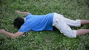 An Asian Thai Male Man Guy Is Drop Dead On The Grassy ...