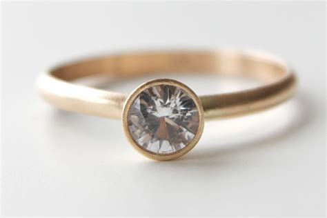 White Sapphire Engagement Ring In 14k Gold Solitaire Ring. Round Cut Rings. Cross Necklace. Colorful Bracelet. Rose Gold Diamond Anniversary Band. Microbrand Watches. Home Made Bracelet. Nomos Watches. Tiffany Soleste Earrings