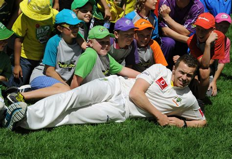 junior season siddle poses with junior cricketers cricket photo