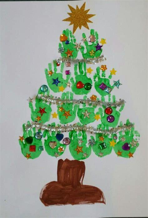 Fensterdeko Weihnachten Fingerfarbe by Christbaum Mit Handabdr 252 Cken Der Kinder Dann Selbst