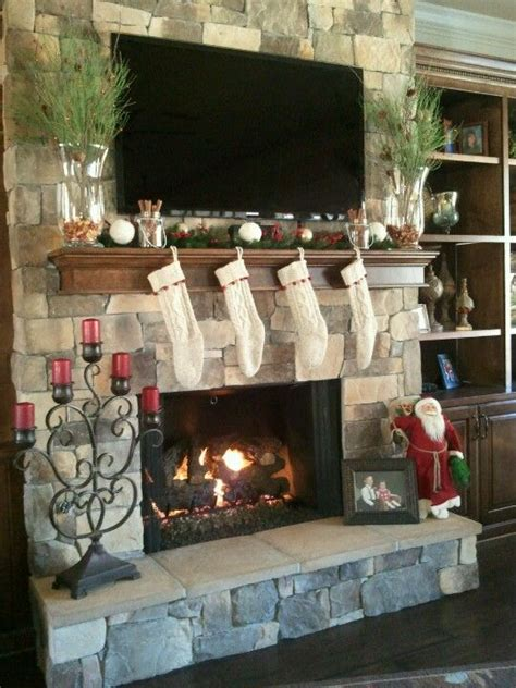 decorating fireplace mantel with tv above mantle