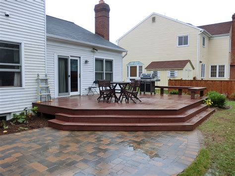 composite deck with paver patio yard