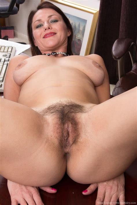 Boss Lady Gina Louise Undresses Behind Her Desk To Display