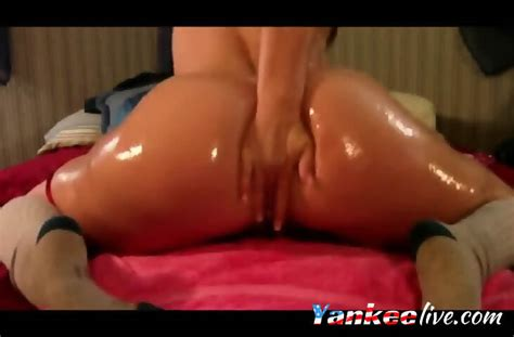 Sexy Oil Wet Babe Stripteasing And Shows Off Her Big Ass