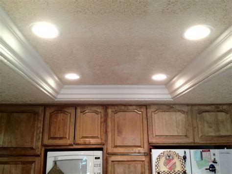 Remove fluorescent lights, replace with can lights and