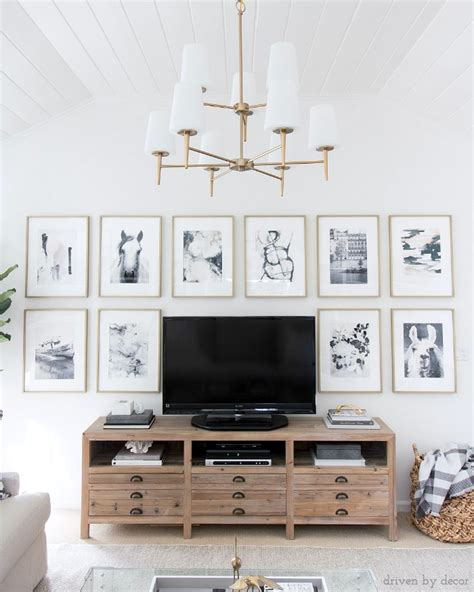 Decorating around a tv can be tricky business. How to Decorate Above the TV: A Simple Solution   Driven by Decor