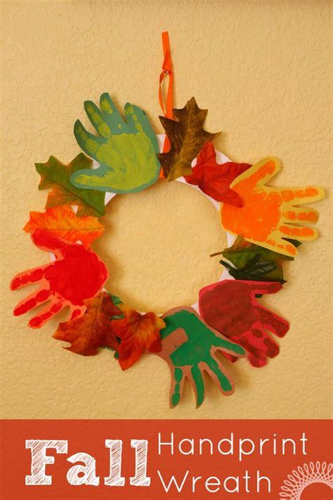 fall handprint wreath evolving motherhood 152   Fall handprint wreath craft for kids