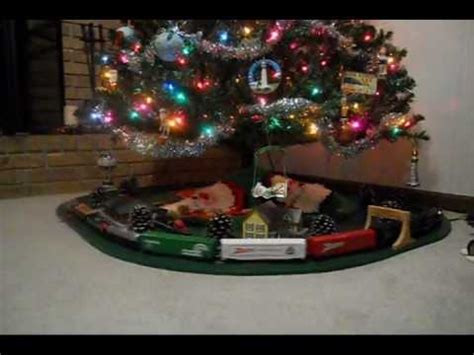 toy train going around top of a tree ho scale model railroad tree in springfield missouri