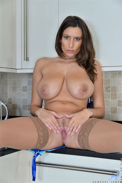 bustyy milf in stockings and high heels spreading pussy lips in kitchen
