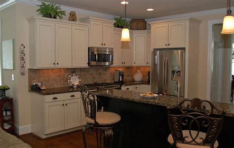 what color countertops with white cabinets corner on pastel wall paint black glass tile backsplash