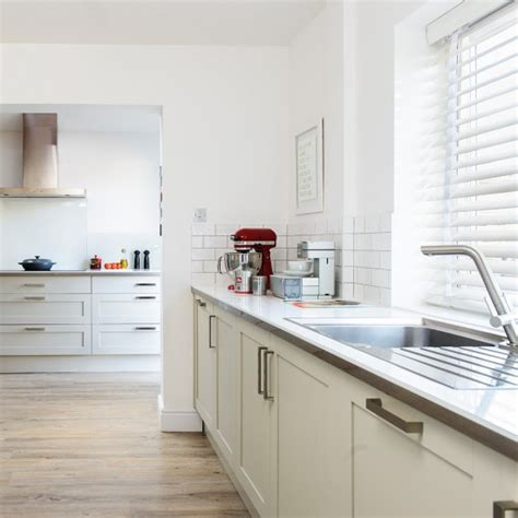 Spacious White Kitchen With Woodeffect Flooring