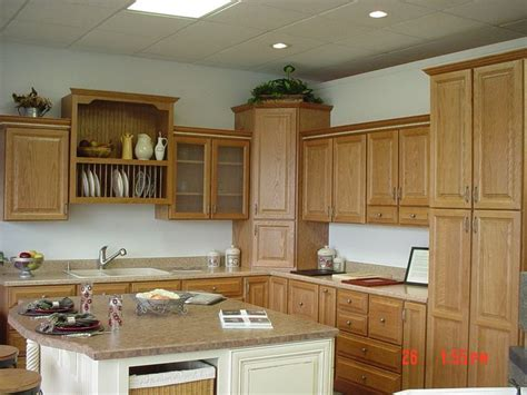 wellborn forest oak madison cabinets in spice with accent