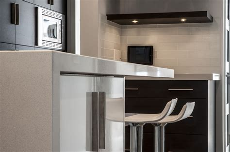 Contemporary Kitchens With Attention To Detail by Waterfall Countertop Detail Modern Kitchens In 2019