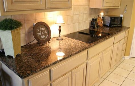 white kitchen cabinets with brown countertops baltic brown granite kitchen countertop neutral white 734 | 5b63637fdab954892f61536a35b67a81 granite kitchen kitchen countertops
