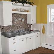 Small Kitchen Remodel Featuring Slate Tile Backsplash Remodelaholic The Front Door Is In The Kitchen And Originally Had A Small Built In Mobile Home Kitchen Remodel Mobile Homes Projects Pinterest Remodel Ranch House Kitchen Love
