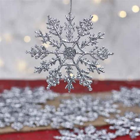 silver snowflakes decorations silver glitter snowflake ornaments winter weddings theme weddings with a theme wedding