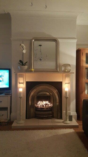 fairy lights mantlepiece mirror candles fireplace